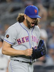 Mets relief pitcher  Robert Gsellman reacts after getting