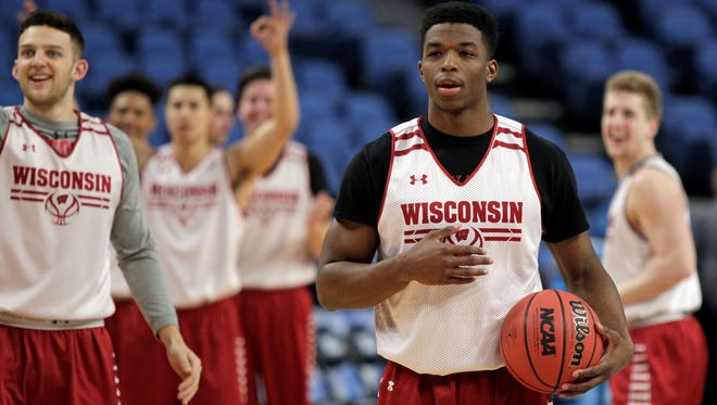 Wisconsin guard Khalil Iverson reacts after hitting his third half-court shot in a drill during practice in Buffalo, N.Y.