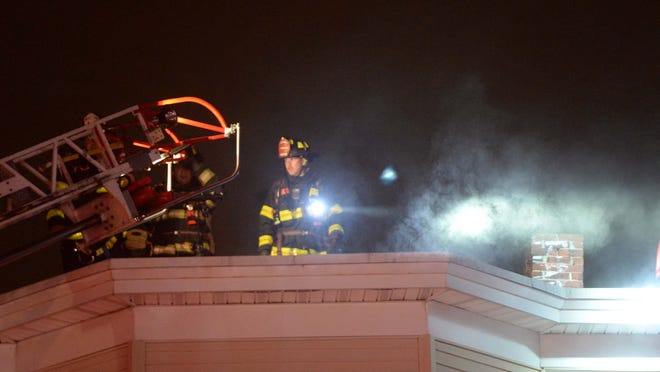Electrical fire in a three-story wood frame house at 88 Denton Street in Brockton, Tuesday, June 30, 2020.