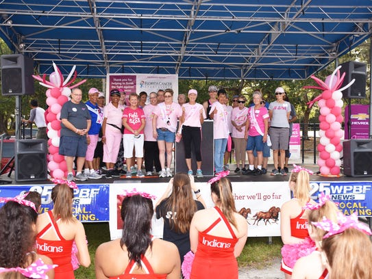 Survivors gather on stage Oct. 21 for the 2017 Making Strides Against Breast Cancer of Indian River walk at Riverside Park in Vero Beach.