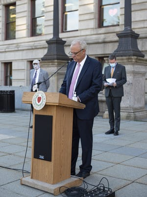 Mayor Joseph Petty gives an update on COVID-19 numbers in the city of Worcester during a press conference outside City Hall Thursday.  Behind him is City Medical Director Dr. Michael Hirsh (left) and City Manager Edward Augustus Jr.