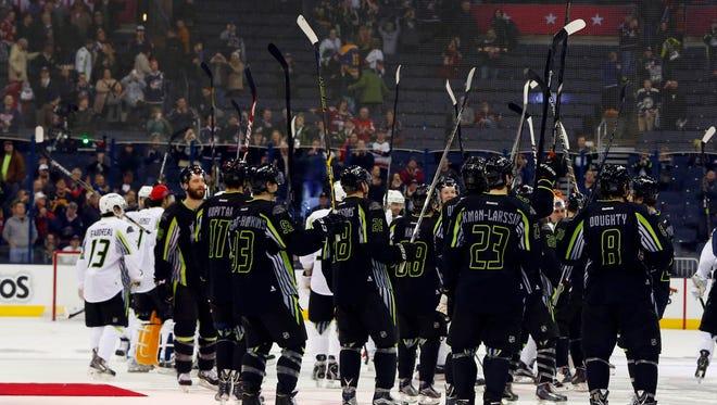 Coyotes defenseman Oliver Ekman-Larsson and members of Team Foligno wave to the crowd after the 2015 NHL All Star Game at Nationwide Arena in Columbus, Ohio, on Jan. 25.
