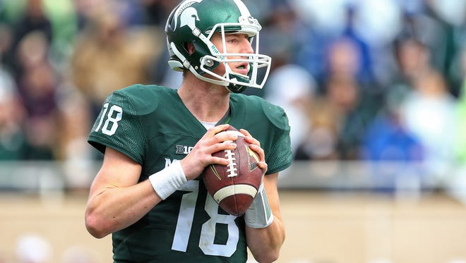 Michigan State Spartans quarterback Connor Cook (18) attempts to throw the ball against the Indiana Hoosiers during the 1st half of a game at Spartan Stadium.