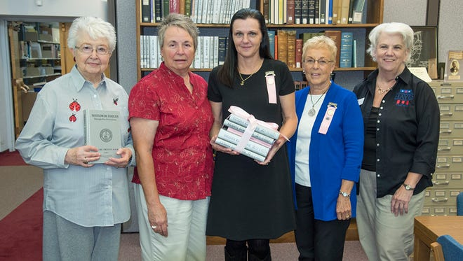 The Toledo Colony of the Society of Mayflower Descendants of Ohio recently donated six Silver Books to the Rutherford B. Hayes Presidential Library.