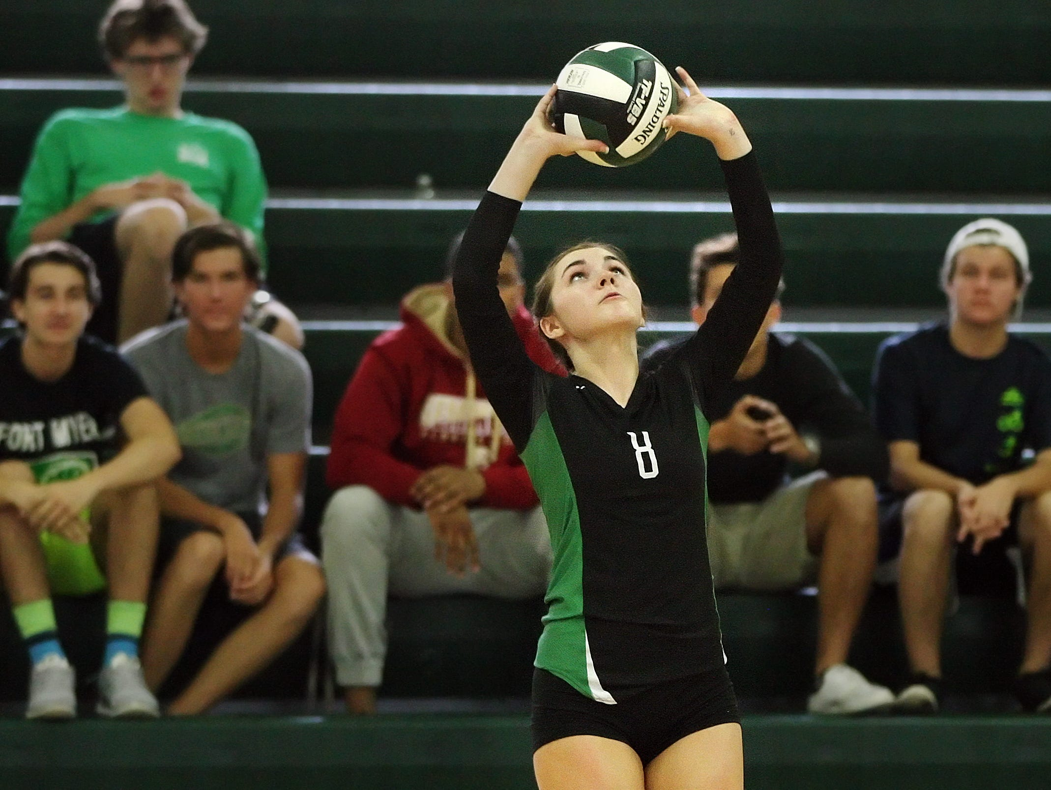 Fort Myers High School's Erin Gear sets the ball against Barron Collier in the Region 6A-3 semifinal volleyball game Saturday at Fort Myers High School. Fort Myers beat Barron Collier 3-0.