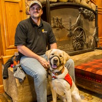 Family trains dogs to help vets for Puppy Jake