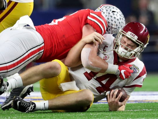 Buckeyes defensive end Sam Hubbard (6) sacks USC Trojans quarterback Sam Darnold (14) during the second half in the 2017 Cotton Bowl at AT&T Stadium.