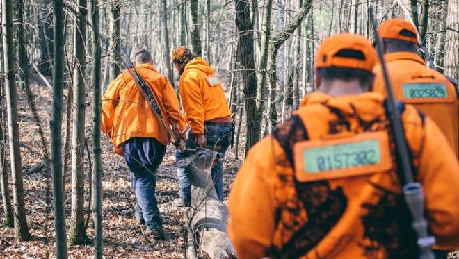 An image from 'Blaze Orange: Whitetail Deer Hunting in Wisconsin' by Travis Dewitz.