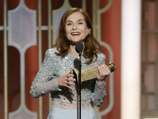 Isabelle Huppert accepts the Golden Globe for best actress in a drama movie for 'Elle.'