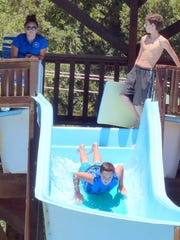 A flume rider takes off at the Ruidoso municipal pool.