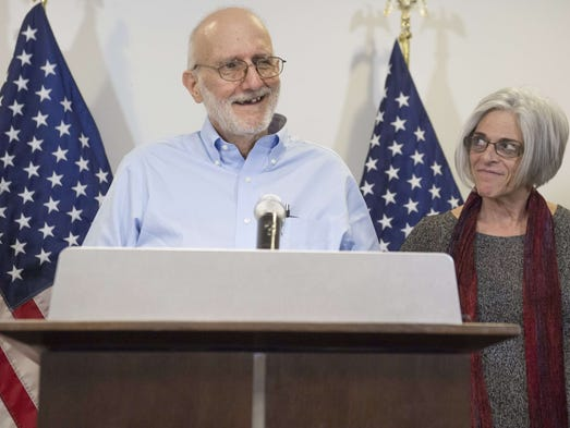Alan Gross, alongside his wife Judy, addresses a news