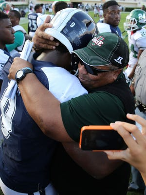 File photo Mississippi Valley State Rick Comegy is working to build the Delta Devils into a SWAC contender. Charles A. Smith/Jackson State Communications Mississippi Valley State coach Rick Comegy, right, hugs his former Jackson State player, quarterback LaMontiez Ivy, after MVSU?s 27-23 victory at Veterans Memorial Stadium on Saturday.