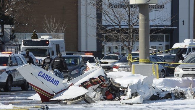 Wreckage from a plane crash sits in a parking lot in Saint-Bruno, Quebec, on Friday. Two small planes collided over a major shopping mall south of Montreal.