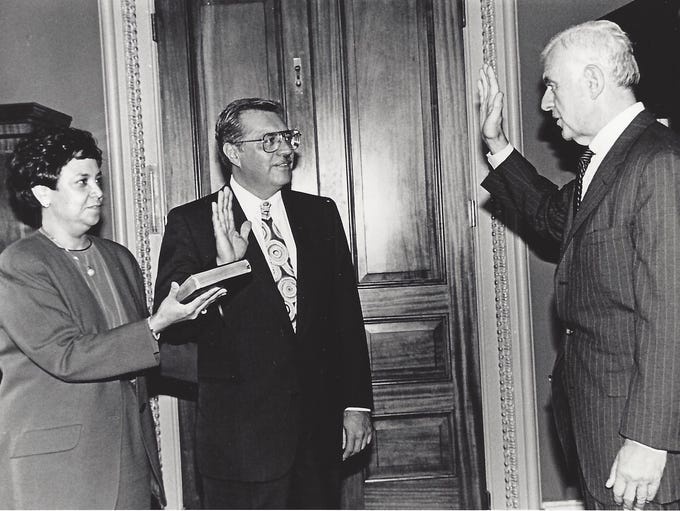 Pastor was sworn in by Speaker of the House Tom Foley on Oct. 3, 1991. His wife Verma Pastor holds the bible.