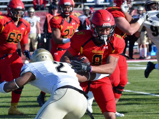 Ferris State running back Davontae Harrington stiff arms Harding cornerback Dra Smith during the Division II football quarterfinal Saturday, Dec. 2, 2017 at Top Taggart Field in Big Rapids.