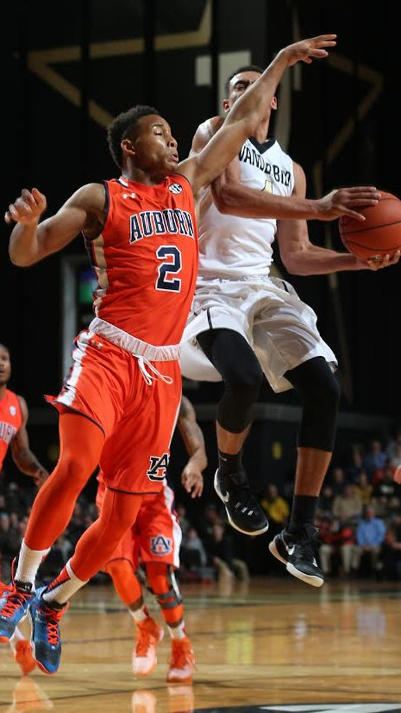 Vanderbilt guard Wade Baldwin IV goes up for a layup against Auburn guard Bryce Brown (2). Brown has tried to help Auburn defensively while going through a 4 for 22 shooting slump in the last three games.