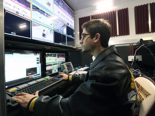 Iona College student Alex Fasano works in the control truck during the live streaming broadcast of the NJIT at Iona men's basketball game for ESPN3 Dec. 14, 2016.