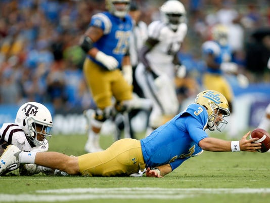 UCLA quarterback Josh Rosen, right, is sacked by Texas A&M linebacker Tyrel Dodson, left, during the first half of an NCAA college football game, Sunday, Sept. 3, 2017, in Pasadena, Calif. (AP Photo/Danny Moloshok)