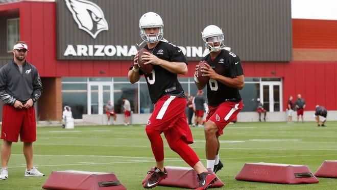 Cardinals quarterbacks Drew Stanton and Logan Thomas during minicamp practice on Wednesday, June 10, 2015 in Tempe, AZ.