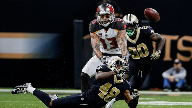 New Orleans Saints safety Vonn Bell (48) breaks up a pass to Tampa Bay Buccaneers wide receiver Mike Evans (13) during the second half of a game at the Mercedes-Benz Superdome.