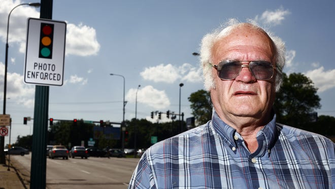 I. L. Wiedermann stands near the intersection of 10th Street and Minnesota Avenue in Sioux Falls, S.D., Wednesday, June 16, 2010. A judge ruled in favor of a lawsuit filed by Wiedermann and said that the city's red light camera ordinance conflicts with state law. (Devin Wagner/Argus Leader)
