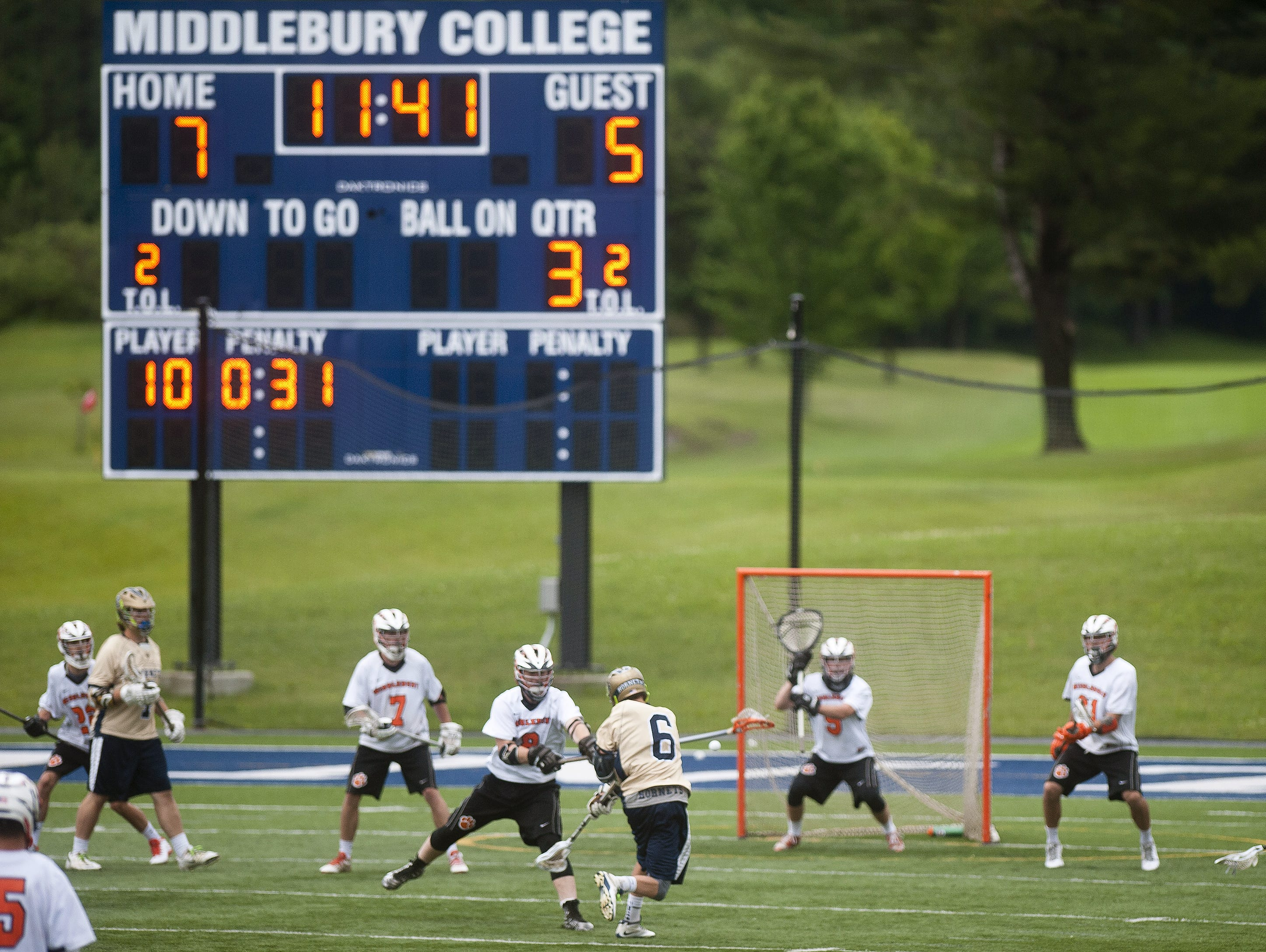 Essex's Joe Galati (6) fires a shot at Middlebury goalie Nathan Lalonde during the second half of Tuesday's Division I boys lacrosse semifinal at Middlebury College.
