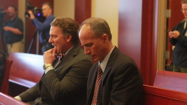 Former NKU Athletic Director Scott Eaton (right) in court on April 17, 2014 to enter a guilty plea to stealing from the university.