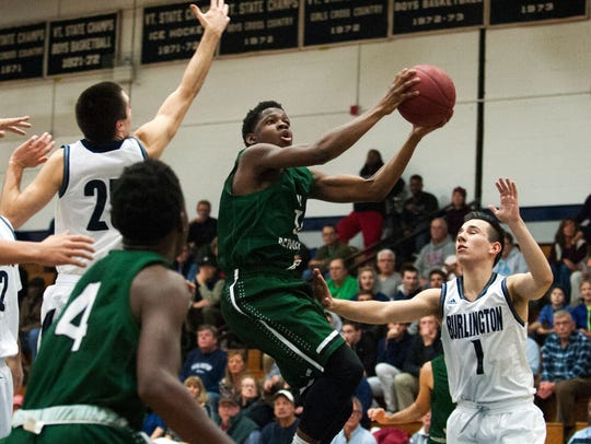 Rice's Ben Shungu (11) leaps over Burlington's Josh