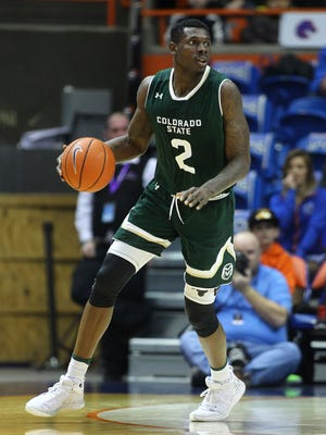 CSU's Emmanuel Omogbo dribbles while looking for an open teammate during a Dec. 31 game at Boise State. Omogbo averages a double-double of 12.7 points and a Mountain West-best 10.6 rebounds a game for the Rams, who play at San Jose State on Wednesday night.