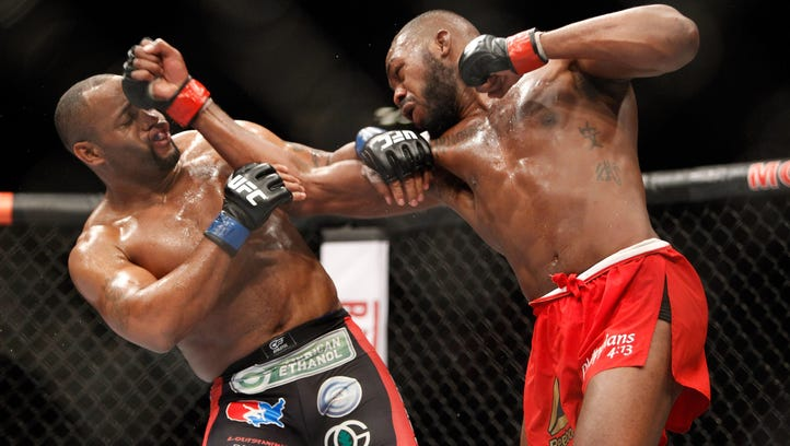 Jon Jones punches Daniel Comier during their light-heavyweight championshp fight at UFC 182. The two may meet again in April.