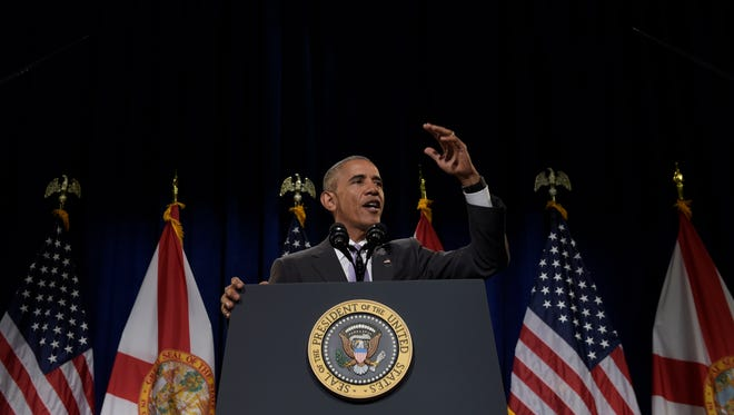 In this Oct. 20, 2016 file photo, President Barack Obama speaks about the Affordable Care Act, at Miami Dade College in Miami. President Barack Obama is leaving the White House in just a few months, but his namesake health care law will still be generating headlines. With premiums rising significantly and some insurers bailing out, the 2017 sign-up season that starts Nov. 1, 2106, could get tricky.