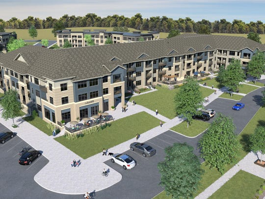 A rendering of what the Howard Commons apartment complex will look like when completed in 2019.