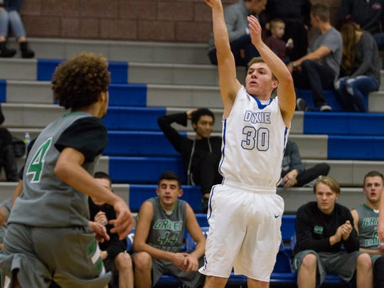 Dixie High holds their lead over Green Valley High for an 89-73 victory Saturday, Dec. 12, 2015.