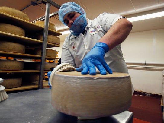 Nick Brummel prepares a wheel of Grand Cru Surchoix