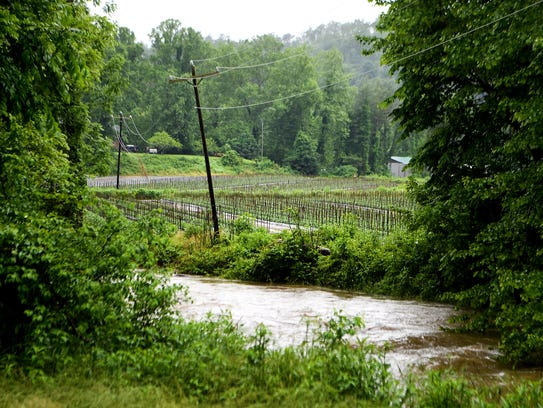 The South Fork of Mills River continues to rise next
