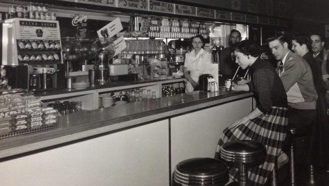 Norma Kennedy works as a waitress in the Critic's restaurant location in Batavia, circa 1955 or 1956. Ernest Criticos closed that location when he moved the restaurant to Greece Towne Mall.