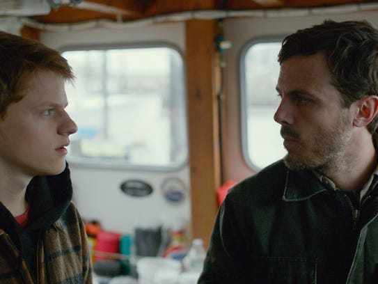 Lucas Hedges and Casey Affleck appear in a scene from