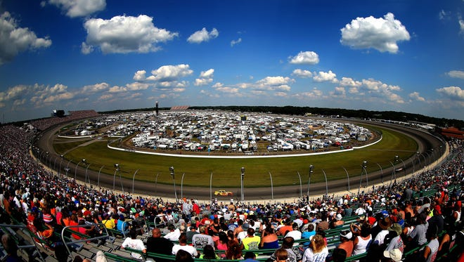 A general view of cars racing during the NASCAR Sprint Cup Series 44th Annual Pure Michigan 400 at Michigan International Speedway on August 18, 2013 in Brooklyn, Michigan.