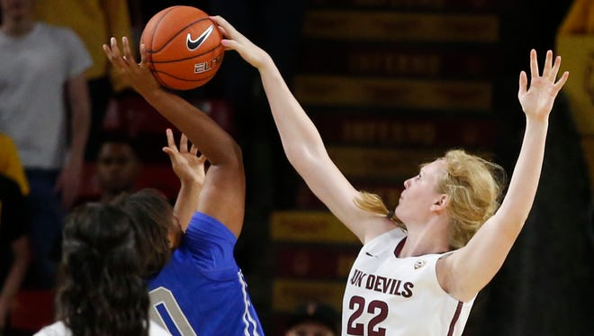 Arizona State's Quinn Dornstauder blocks a shot by Middle Tennessee's Caya Williams during the second half at Wells Fargo Arena in Tempe on Nov. 14, 2014.