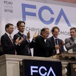 Fiat Chrysler Automobiles CEO Sergio Marchionne, third left, and company Chairman John Eikann, fourth left, gavel trading closed after ringing the closing bell, of the New York Stock Exchange, as NYSE Chairman Tom Farley, right, applauds on Monday.