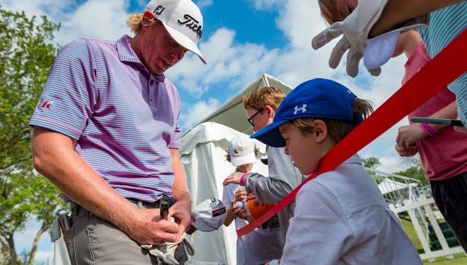 Mark Anderson signs a glove for a young fan following the final round of the Web.com Tour Chitimacha Louisiana Open at Le Triomphe Golf and Country Club. Sunday, March 25, 2018.