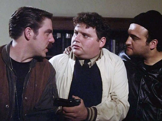 Bruce McGill (from left), Stephen Furst and John Belushi