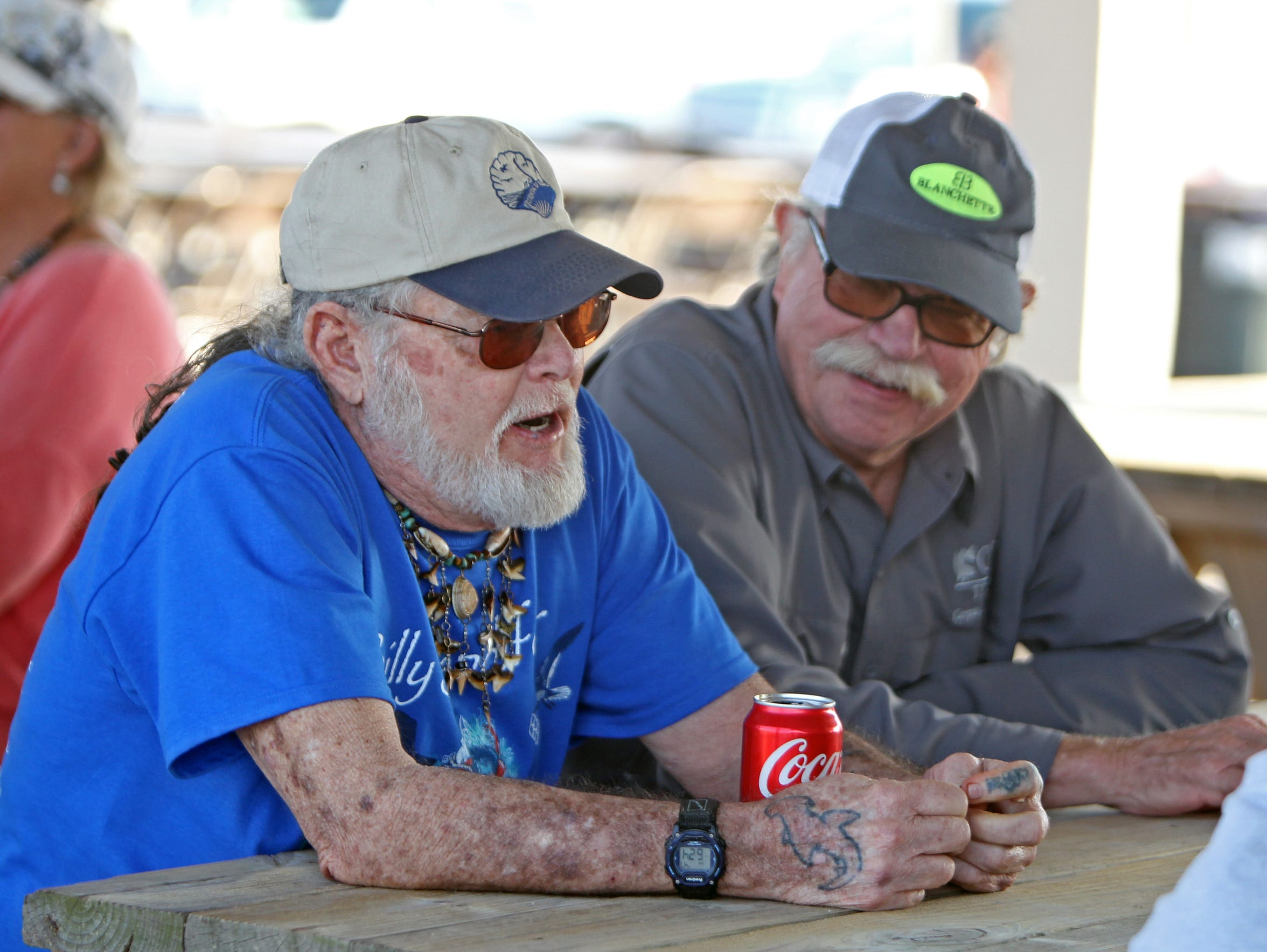 Billy Sandifer and David McKee reminisce at Mark 37 Marina in 2017 during the induction of Doug Bird as a Legend of the Laguna Madre.
