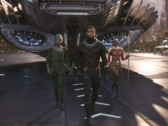"Production designer Hannah Beachler helped create the world-building within ""Black Panther,"" starring Chadwick Boseman, center, as the title character."