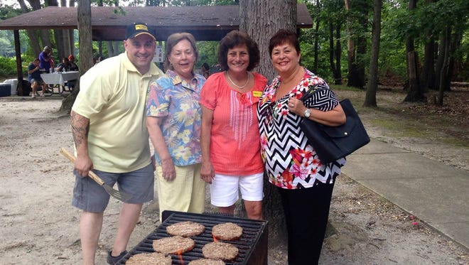 Members of the Weichert, Realtors office in Old Bridge, shown here, East Brunswick, Edison, Metuchen, South Brunswick and Middletown held a fundraiser picnic on Aug. 1 and raised $1,200 for breast camcer research.