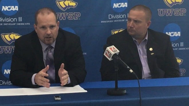 UW-Stevens Point football coach Greg Breitbach, left, answers a question Monday afternoon during a media conference announcing his hiring as Pointers athletic director Brad Duckworth listens.