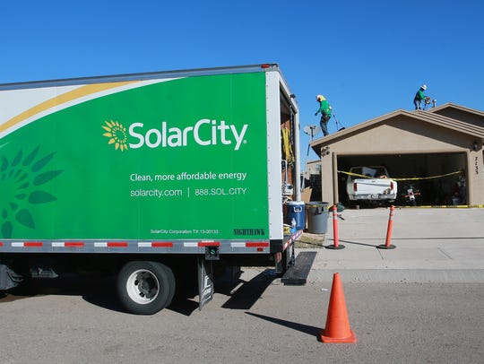 SolarCity workers installed a solar rooftop system