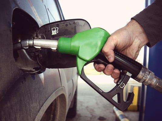 Fill up fuel at petrol station