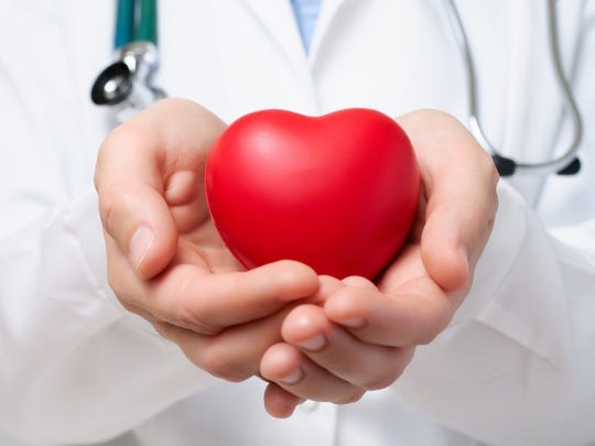 Doctor holding a heart shaped object