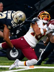 New Orleans Saints cornerback Marshon Lattimore (23) breaks up a pass intended for Washington Redskins wide receiver Josh Doctson (18) in the first half of an NFL football game in New Orleans, Sunday, Nov. 19, 2017. (AP Photo/Butch Dill)